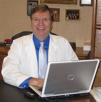 Picture of Dr. Rabalais in his dental office.